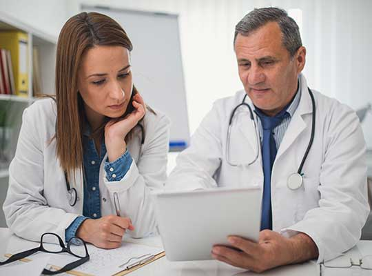 doctor looks at medical history with a dnp