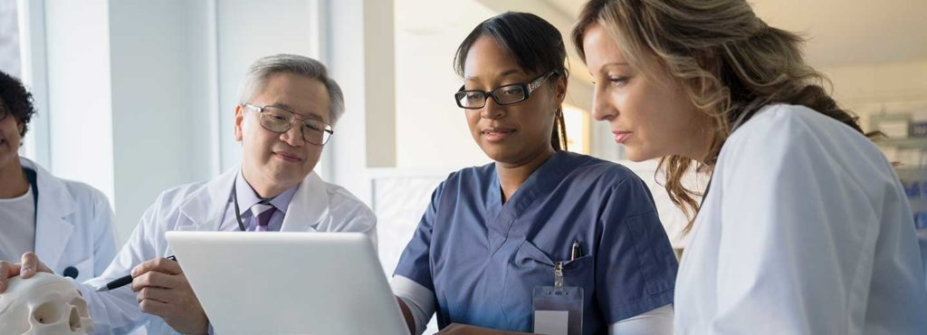nurses study for their msn online with a laptop